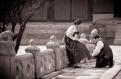 Candid moment during wedding shoot | Seoul, South Korea (Faithful Freja) Tags: seoul southkorea blackandwhite streetphotography travelphotography traditionaldress traditional couple outdoor outdoors shrine temple memorial engagement photoshoot engagementphotography couplephotography changgyeonggungpalace changgyeonggung palace hanbok candid winter cinderella cinderellamoment wedding traditionalwedding weddingphotography wonderful world wonderfulworld happy love