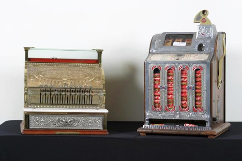 Mills Coin Operated Slot Machine ($896.00); Brass National Cash Register ($560.00)