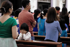 in the mass (-clicking-) Tags: streetphotography streetlife church mass children childhood childish child innocence innocent catholic moment bore boring saigon vietnam religion