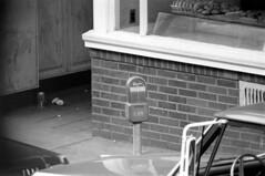 h5-68 05 (ndpa / s. lundeen, archivist) Tags: nick dewolf nickdewolf bw blackwhite photographbynickdewolf film monochrome blackandwhite city summer 1968 1960s 35mm boston massachusetts candid streetphotography citylife streetlife beaconhill charlesstreet car vehicle automobile parkedcar parkingmeter violation timeexpired openwindow steeringwheel store shop window storewindow bakery bakedgoods doughnuts donuts entrance onehour