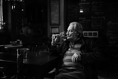 The light drinker (Giulio Magnifico) Tags: life lighting city light inspiration man black detail reflection history glass bar composition contrast vintage dark happy intense thought alone loneliness shadows emotion wine expression candid character profile citylife thoughtful streetphotography saturday thoughts elder aged gaze glance osteria genuine udine nikond800e sigma35mmf14dghsm