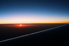 Waking Up The Sun (OzGFK) Tags: morning sky sun clouds plane sunrise flying asia flight wing windowseat