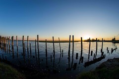 DSC_0525 (logancros) Tags: ocean old red sea summer sky orange reflection beach water clouds skyscape landscape fire bay pier peace dusk calm shore worn destroyed tranquil silouhette