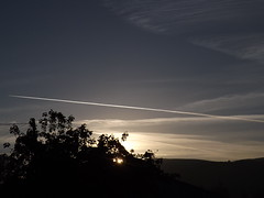 solar radiation management sunrise blocked (rospix) Tags: uk blue light sky cloud tree nature weather june wales clouds plane sunrise dawn countryside flight hills chemtrails 2014 globaldimming geoengineering weathermodification rospix solarradiationmanagement stratosphericaerosolspraying