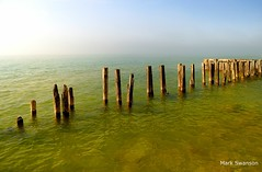 Pilings - Explore (mswan777) Tags: sun lake seascape color beach nature water fog outdoors nikon rocks waves michigan great lakes pilings polarizer d5100