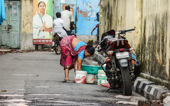 Washing Clothes on Street (tathamondal) Tags: street woman india vibrant indian dirty clothes washing calcutta slum