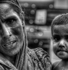 'I can't feed my child, but you can..' (helterskelter.711) Tags: poverty street blackandwhite bw beautiful canon blackwhite asia child sad bokeh beggar reality dhaka starvation bangladesh hdr starved heartbreaking 60d taqbirhudaportfolio