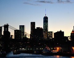 World Trade Center (Little Italy Photography) Tags: newyorkcity sunset newyork architecture clouds nikon cloudy fireworks streetlamps manhattan worldtradecenter fair clear financialdistrict brooklynbridge manhattanbridge eastriver fourthofjuly hudsonriver lamps statueofliberty chryslerbuilding july4th independenceday bigapple fdny fdrdrive williamsburgbridge metlifebuilding unitednationsplaza historicbuildings pier36 citicorpbuilding fireboats greelysquare fdnyems nydp nikond90 nikon70300mmf4556gedifafsvrzoom nikon18105mmf3556gedifafsvrnikkorzoomlens 299southstreet grandcentralstationclocks