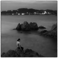 Mermaid or Virgin Mary (Masahiko Kuroki (a.k.a miyabean)) Tags: sea bw noiretblanc explore le sq 葉山 森戸海岸 fujixe1 fujifilmsuperebcxf2841855mm
