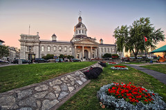 Kingston City Hall (Ontario, Canada) (Andrea Moscato) Tags: andreamoscato canada america view vista vivid sunset tramonto evening sera parco park building architecture architettura city città cielo green blue red flowers grass stones trees light shadow people car