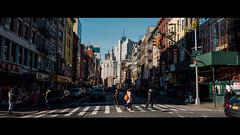 Crossed (Panda1339) Tags: crossingstreet 28mm leicaq summiluxq manhattan nyc newyorkcity streetphotography chinatown usa people