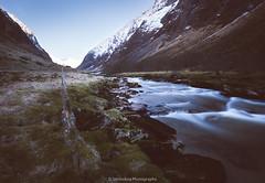 Sunny day, dark valley (Steinskog) Tags: norway mountains river snow longexposure
