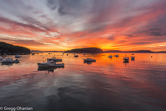 Bar Harbor sunrise (greggohanian) Tags: sunrise maine barharbor acadia lobsterboats boats islands harbor calm reflection sky colorful fireinthesky downeast coastal coastalmaine moorings buoys clouds porcupineislands island