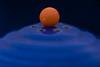 Orange Candy on a Blue Fiesta S/P Shaker (NedraI) Tags: candlestickholder fiestaware macro candy blueandorange balance saltandpeppershaker vintage round holes fiesta orangeandblue macromondays