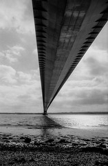 Under the bridge where the trolls live (Richie Rue) Tags: olympus om1n 35mm mono monochrome blackandwhite film film:brand=foma film:iso=100 bridge under light river humber estuary