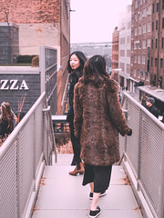 Catwalks Are Everywhere... (Jon Cartledge) Tags: smooth warm contrast shadow toning dreamy pastel vignetting olympus em5 sigma 30mm f28 ex dn girls asian women cute smiling happy fashion new york city highline usa nyc fur coat street people