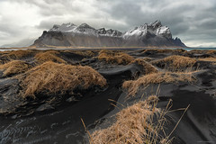 Scrape the sky (MRC Imagery) Tags: iceland mountain mountains vestrahorn dunes sand blacksand volcanicsand clouds cold wind winter landscape snow 1635mm 5dmk3 beach contrast sanddunes mountainside outdoor adventure