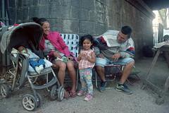 Domingo en familia en Santiago Vázquez (Nando.uy) Tags: nandouy montevideo uruguay analog film 35mm filmisnotdead ishootfilm nikon f3 chinon 28mm f28 kodak ektar 100 santiago vazquez familia candid street calle