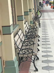 Benches in DeLand, Florida (soniaadammurray - On & Off) Tags: iphone benches benchmonday facade pipes bicycle people sidewalk signs chairs streetscene 2017 deland florida usa