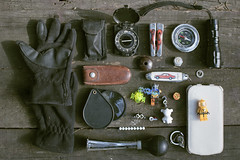 The survival kit of eight-year boy (Khuroshvili Ilya) Tags: things compass knofe phone boy kit survive gloves pattern wood light toys childhood items children kid child concept frontview magnifier horn klaxon lego skull outdoor