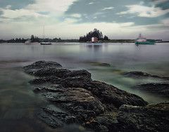 Blue Rocks, Nova Scotia (creditflats) Tags: nik olympus ep5 pen bluerocks novascotia coast rocks maritimes shed boat water longexposure atlantic calm texture