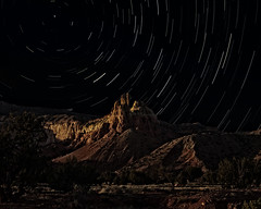 Chimney Rock and the Piedra Lumbre badlands at Ghost Ranch (Mitch Tillison Photography) Tags: longexposure newmexico southwest night landscape photography photo nighttime badlands abiquiu ghostranch chimneyrock startrail starscape georgiaokeeffe starryskies pentaxk5 mitchtillison pedralumbre