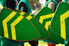 green shields (annie_stothert) Tags: green yellow fight battle knights soldiers chevron reenactment shields
