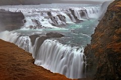 Gullfoss - Thanks for the 10,000 views! (Brent Mooers Photography) Tags: longexposure misty umbrella canon waterfall iceland amazing movement tripod 7d second nik f22 12 raining gullfoss springtime drizzle wetfeet 1755mm worththetrip snapseed
