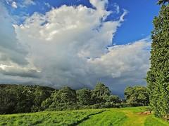 Stormy Surrey (Deepgreen2009) Tags: sky cloud storm home weather garden dark shower threatening surrey hills norhdowns