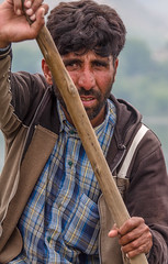 Shikara Boatman (Mike Prince) Tags: india man water transport lakes unknown rowing kashmir boatman shikara lakemanasarovar jammuandkashmir boatsandships jobsandcareers manasballake natureandenvironment cultureandcommunities