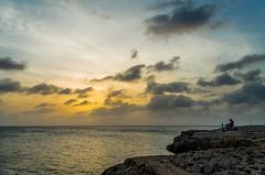 Enjoying Life (Moppii) Tags: ocean life blue sunset sea people orange yellow vivid shore enjoy foreground