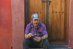 churros on the street (camelot98.) Tags: street leica city travel portrait urban man color lines mexico candid streetphotography streetportrait mexican sanmigueldeallende guanajuato summilux sma churros m9