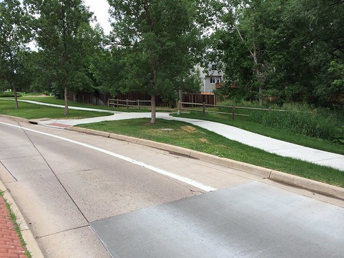 Photo - Spine Road Between White Rock Circle & South Orchard Creek Circle/Wellington Road