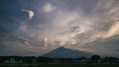 Not So Empty Sky (jasohill) Tags: city summer sky color green nature leaves japan clouds evening landscapes rice paddy dreams  puffs lenticular  tohoku hachimantai buildingssky