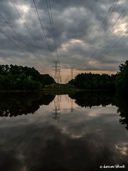 Newcombs Lake (Duncan Brook) Tags: sunset sky usa lake reflection tower water clouds us nc durham symmetry wires powerline iphone powercompany mountainstoseatrail iphone5s newcombslake
