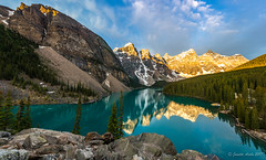 Moraine Lake panorama (NettyA) Tags: 2014 alberta banffnationalpark canada canadianrockies morainelake northamerica sonynex6 valleyofthetenpeaks hiking mountains panorama summer travel sunrise reflection rocks rockpile clouds extraordinarilyimpressive