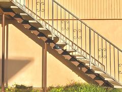 metal and concrete staircase (Lynn Friedman) Tags: 94015 dalycity outside nobody dusk earthtones brown sienna staircase concrete metal midcenturymodern retro architecture favstock editedversion