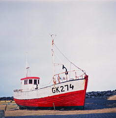 GK274 (Balthasar Phragmites) Tags: pentacon six carl zeiss jena biometar 80mm f28 fuji 120mm roll 6x6 medium format ship boat fisherman wreck dull cloudy iceland ísland gardur square horizon ocean atlantic film grain noise analogphotography analogcamera analog analogphotohrapher analogue analogvibes analogia filmphotography filmisnotdead filmcamera filmgrain filmism positive celluloid scan scanned provia 100 zomeifilter zomei filter slidefilm squareformat