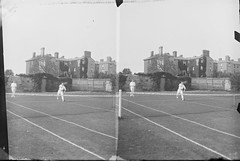 Stereo view of tennis court with a doubles match taking place, large house in the background (National Library of Ireland on The Commons) Tags: theclonbrockphotographiccollection lukegeralddillon baronclonbrock augustacarolinedillon baronessclonbrock dillonfamily nationallibraryofireland tennismatch doubles mens whitelongslacks flannels locationidentified ailesburyroad tennis dublin meldon louismeldon ailesburywoods