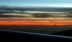 New Day (Khaled M. K. HEGAZY) Tags: nikon coolpix p520 singapore nature outdoor closeup plane sun sunrise sky cloud yellow blue white orange black