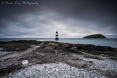 Penmon Lighthouse (.Brian Kerr Photography.) Tags: anglesey lighthouse northwales wales seascape photography seascapephotography outdoorphotography outdoor landscapephotography puffinisland photo briankerrphotography briankerrphoto cold freezing beach pebbles rocks goldsworthy clouds sky sunset blue mood atmosphere a7rii availablelight sony penmonlighthouse