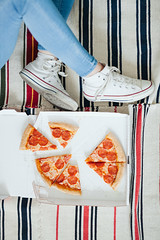 girls eats pizza at home, view top legs (SiberianImages) Tags: closeup food pizza top view above bake basil copy cuisine dinner dish fast fresh ham herbs homemade italian left margarita meal meat mediterranean mozzarella olive pepper red rustic salami sauce sausage served space tomato traditional vegetable vegetarian attractive beautiful beauty beverage box girl hipster legs 20s 2025 strip mehendi henna