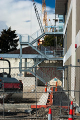 Getting the Carpark Done (Jocey K) Tags: road street trees newzealand christchurch sky cars architecture clouds tags stairway cranes trucks constructionsite buldings rebuild roadcones