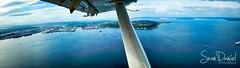 A Fly by Alki (Sean Daniel) Tags: seattle blue sea beach plane nikon air alki coolpix pugetsound kenmore floatplane flyaway naturescene