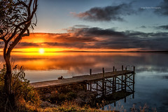 Old jetty at Dawn (Jacqui Barker Photography) Tags: sunrise reflections pier jetty coastal oldjetty oldpier orangetones