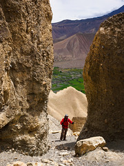 Cliffs above Dhakmar (whitworth images) Tags: nepal red man male nature beautiful yellow trekking landscape outdoors person asia hiking scenic rocky dry scene cliffs hills erosion jacket stony mustang geology himalaya arid steep eroded restrictedarea geologicalfeature uppermustang annapurnaconservationarea dhakmar