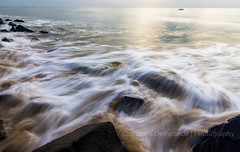 'Coming Through in Waves... A distant Ship...on the Horizon' (Chaitanya Deshpande | Photography) Tags: longexposure sea seascape motion beach sunrise canon pondicherry bayofbengal longexposurephotography rocksonthebeach seamotion