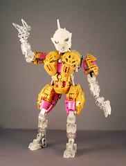 Freya (0nuku) Tags: bionicle lego toa crystal quartz pink gold clear crast kanohi custom mask prosthetics amputee