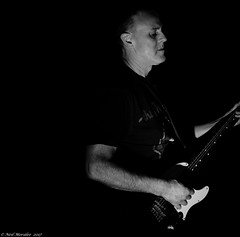 Rythm In The darkness. (Neil. Moralee) Tags: anything but thatneilmoralee band man guitar chord rythm music play perform dark song black white mono monochrome contrast bold bw bandw blackandwhite blackbackground nikon d7100 flash neil moralee 18300mm zom concert darkness loud punk rock blues jaz country metal garage folh electric face portrait balding ear ears sound