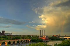 Rainbow over the milling district (schwerdf) Tags: bridges cloudscapes endlessbridge goldenhour guthrietheater hdr i35wstanthonyfallsbridge millingdistrict minneapolis minnesota southeaststeamplant stonearchbridge tcrt thunderclouds